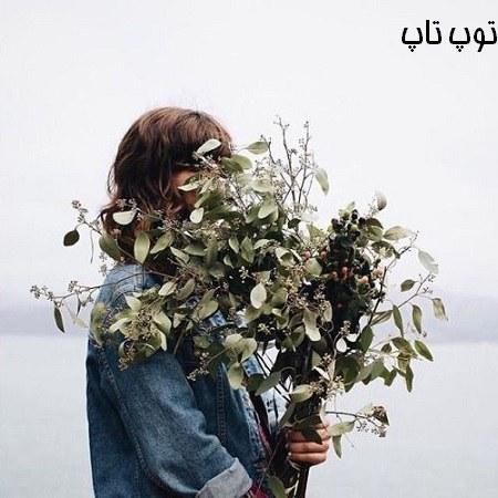 تصویر دختر با گلهای پاییزی در دست مخصوص پروفایل