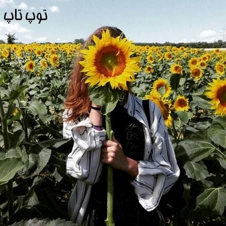 دانلود عکس دختر با گل در دست