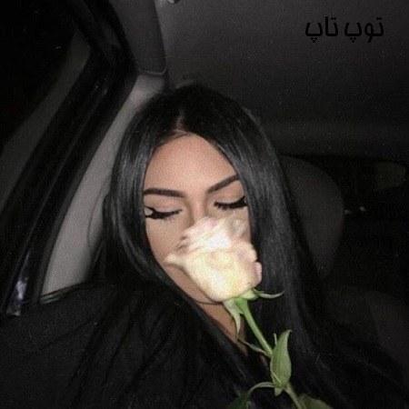 عکس دختر با گل سرخ