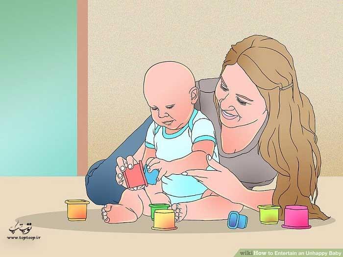به کودک ناراحت اسباب بازی های مورد علاقه اش را بدهید