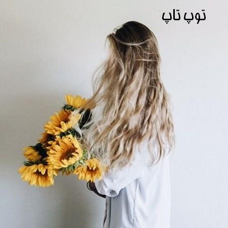 عکس دختر با گل آفتابگردان