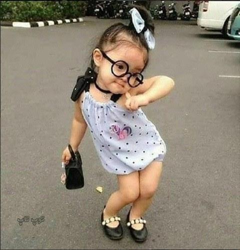 عکس بچه بانمک خنده دار