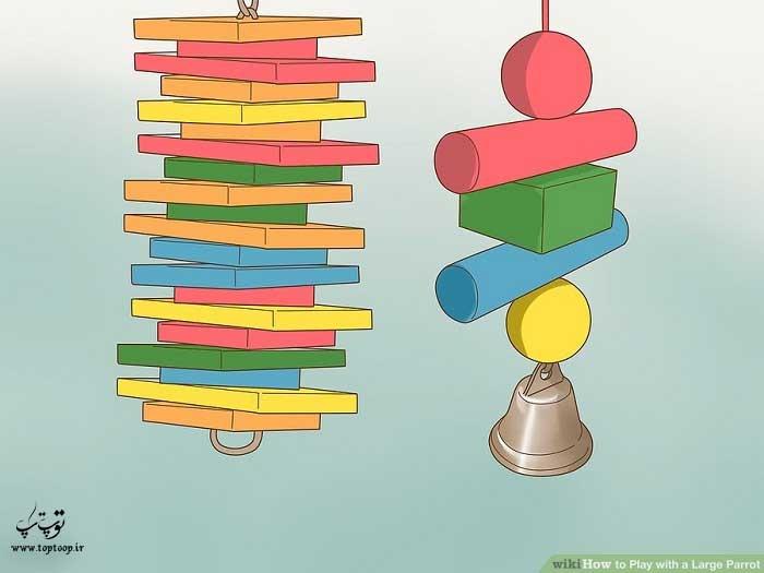 استفاده از اسباب بازی های چوبی برای بازی با طوطی