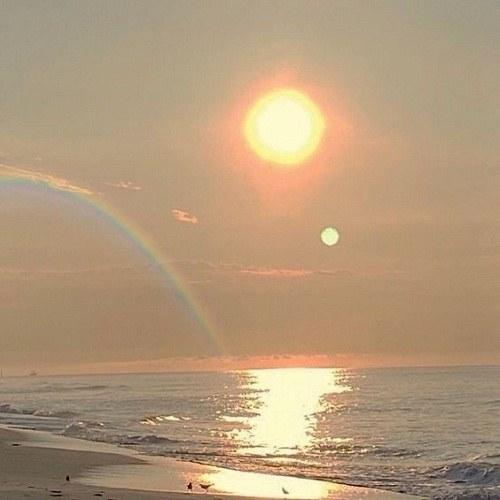 عکس پروفایل ساحل دریا و رنگین کمان