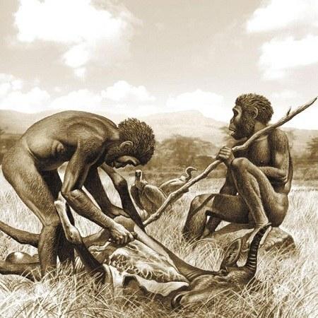 عکس انسان اولیه در حال خوردن غذا